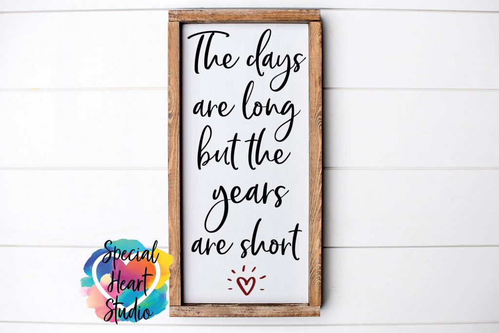 """SVG file saying """"The days are long but the years are short"""" on a sign mockup"""
