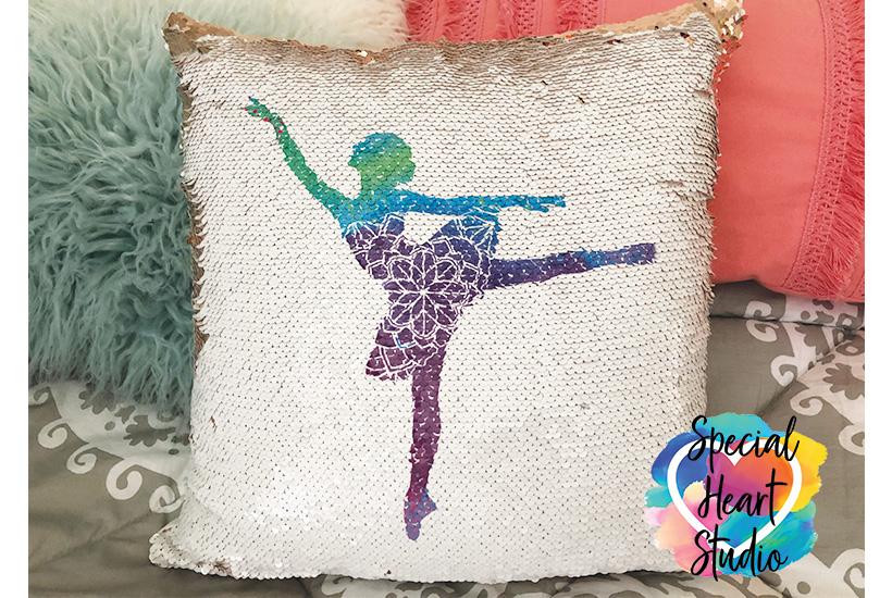 White sequin flip pillow with ballerina