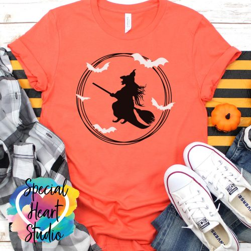 Flying witch and bats on orange shirt