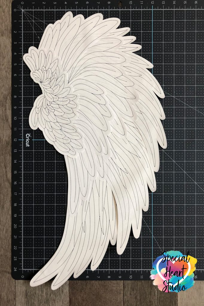 26 inch tall Angel Wing made of paper with Cricut Machine. Black outline of feathers