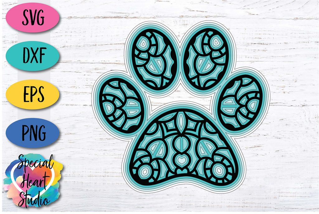 Illustration of layered paw print on white wood background SVG DXF EPS and PNG with Special Heart Studio logo