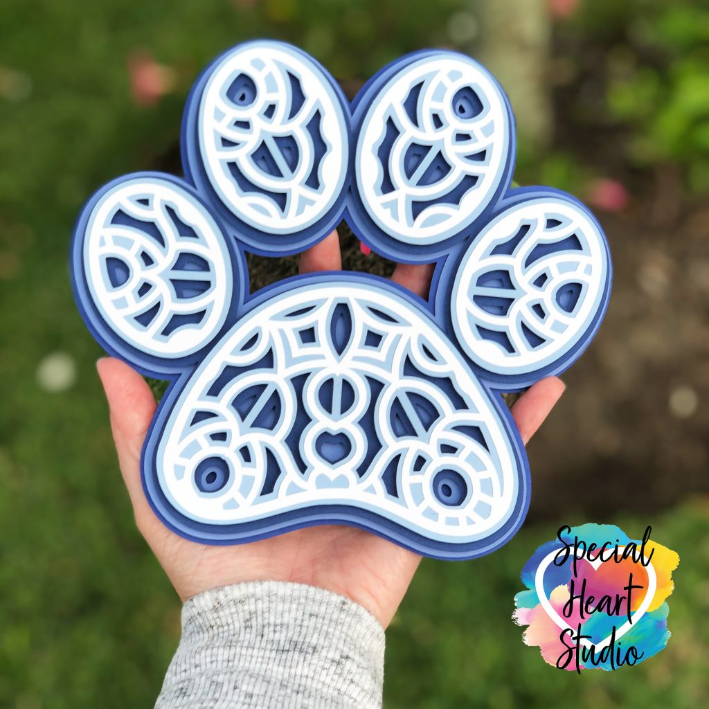 layered cardtock blue and white paw print mandala
