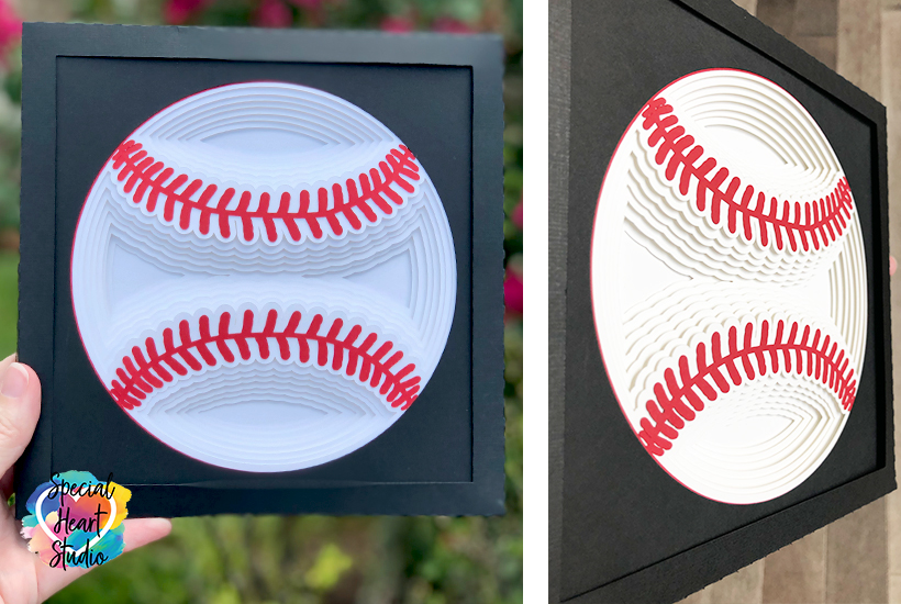 Layered baseball made with cardstock in a black frame.