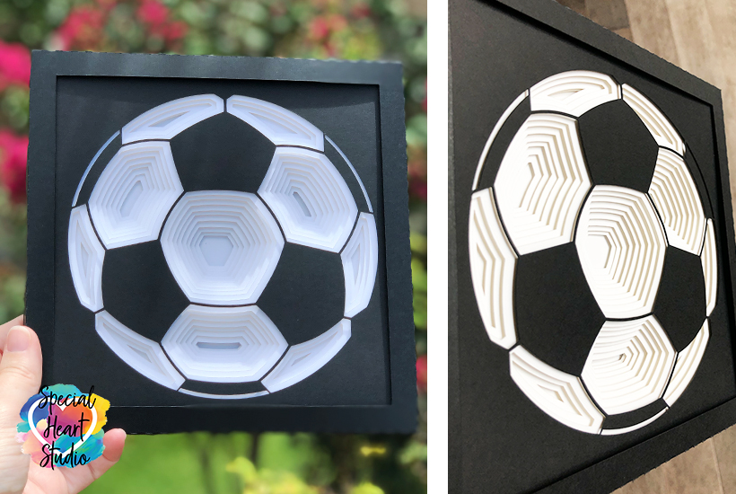 Layered soccer ball shadow box front and side angle view.