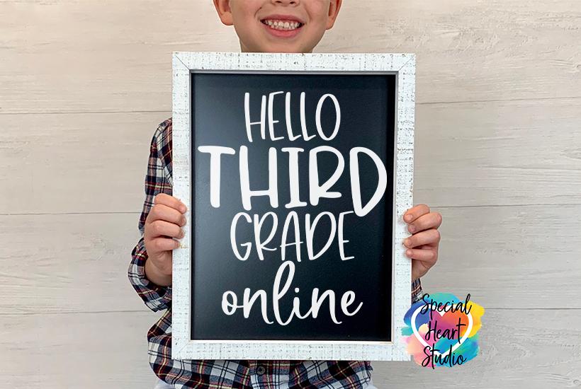 Boy holding chalk board saying Hello Third Grade online