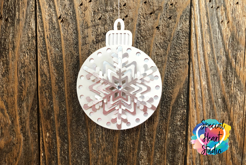 Layered Snowflake Christmas Ornament made from white and silver cardstock.