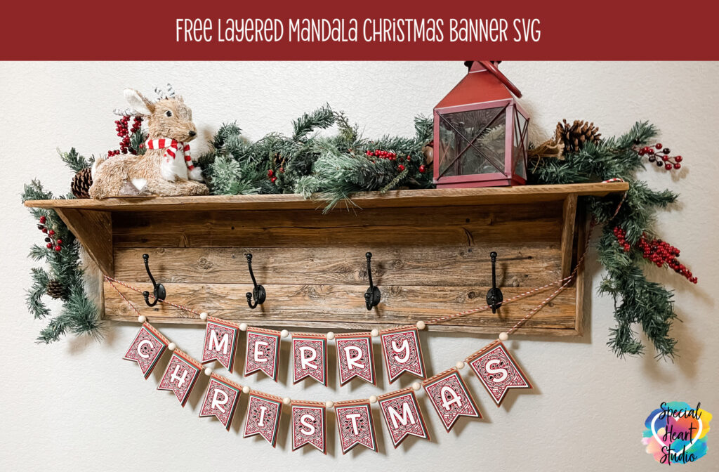 Layered Merry Christmas Banner hanging from shelf with coat hooks.