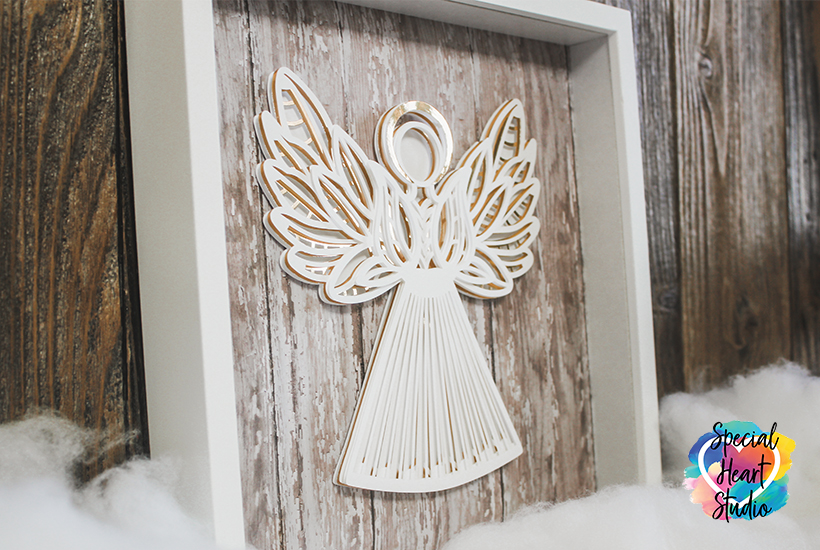 Framed Cardstock Angel in layers on wood background