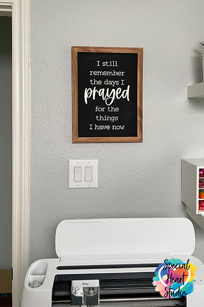 "Completed Reverse canvas sign hanging in craft room.  Sign is black with white writing saying ""I still remember the days I prayed for the things I have now"""