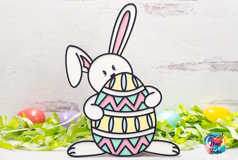 White Easter bunny from cardstock with easter grass and eggs.