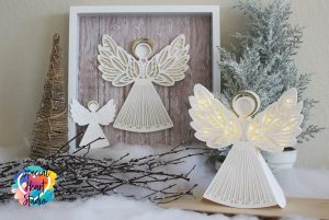 Three White cardstock layered paper angels