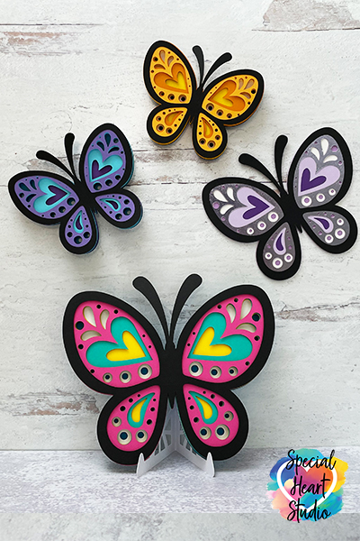 Four colorful butterflies made from cardstock.