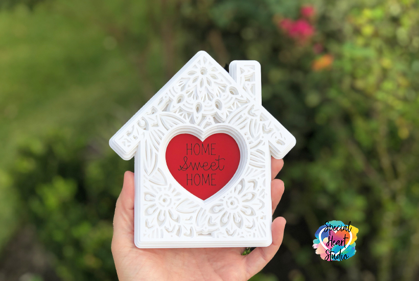 Layered mandala house made from white cardstock with red heart in middle